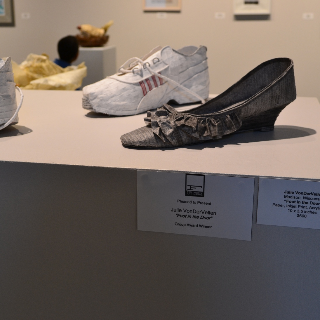 These shows were in an exhibit that requried all the artwork to be made on or of paper. So these shoes are made from paper!