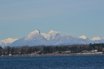 A view of the northern Cascades & water from Birch Bay State Park in Blaine, WA.